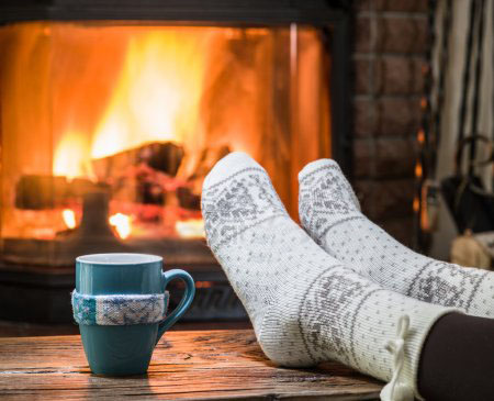 depositphotos_116341630-stock-photo-warming-and-relaxing-near-fireplace